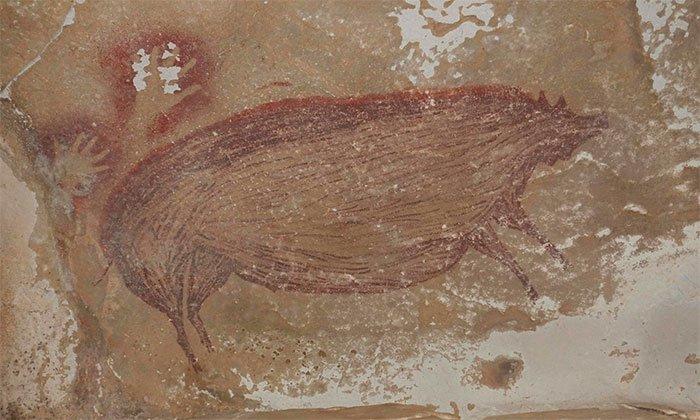 Bức tranh hang động cổ nhất thế giới được tìm thấy ở Indonesia