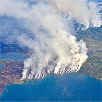 Bắc Cực bùng cháy, đe dọa mở nắp