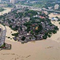Nước cuồn cuộn đổ về đập Tam Hiệp, Trung Quốc oằn mình chống lũ